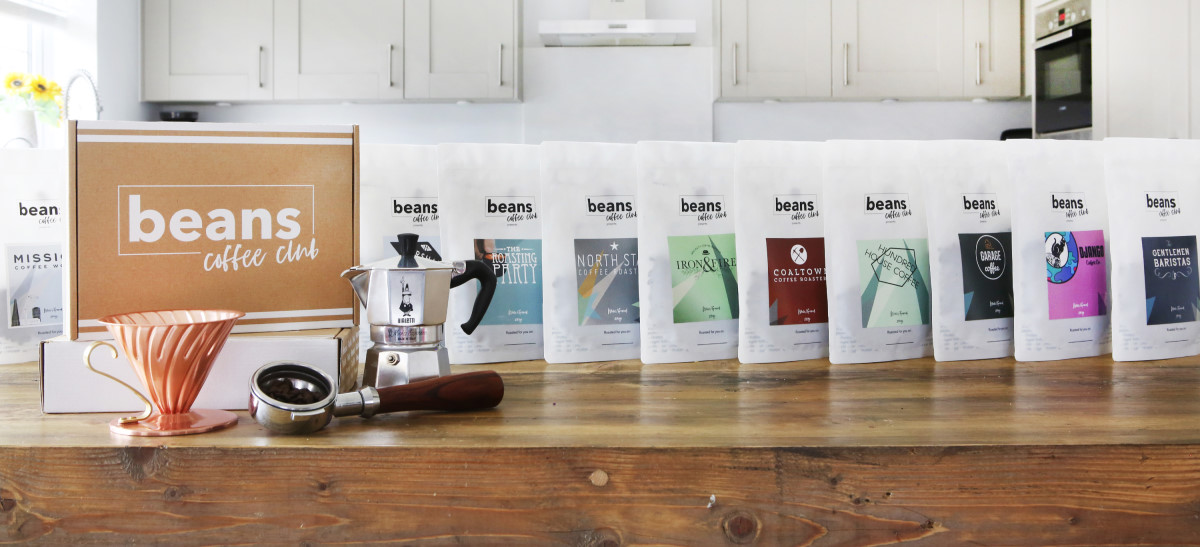 A cafetiere and an array of beans coffee bags